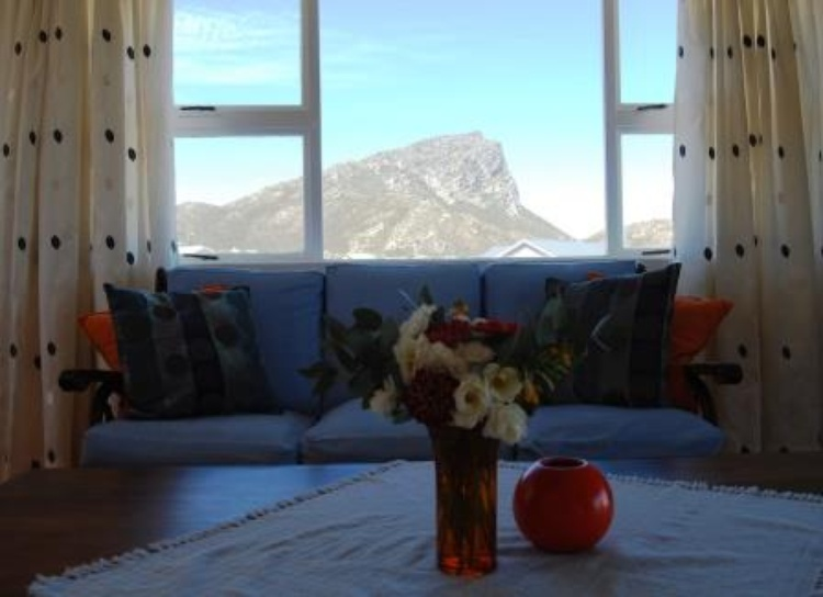 Living room with beautiful mountain view and balcony