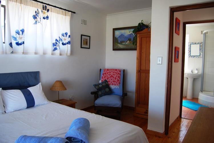 Main bedroom with balcony.