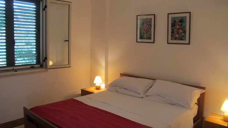Main bedroom with double bed, wardrobes and dressing table