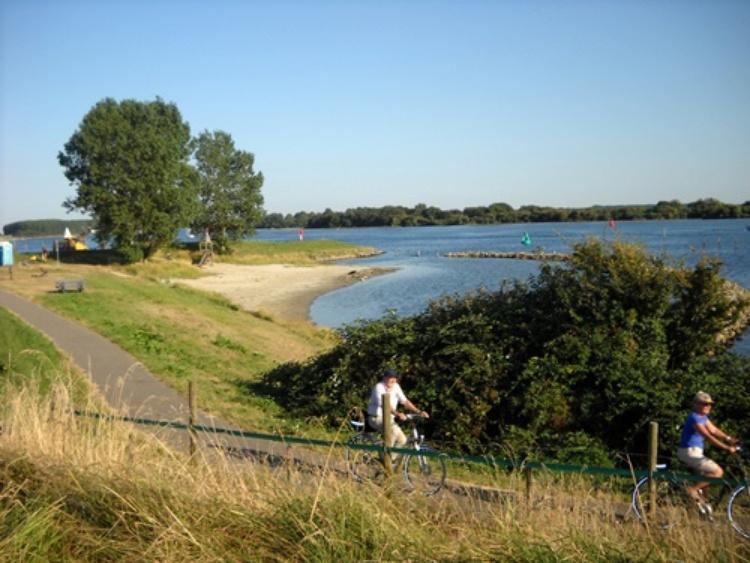 enjoy riding on a bike along the shore