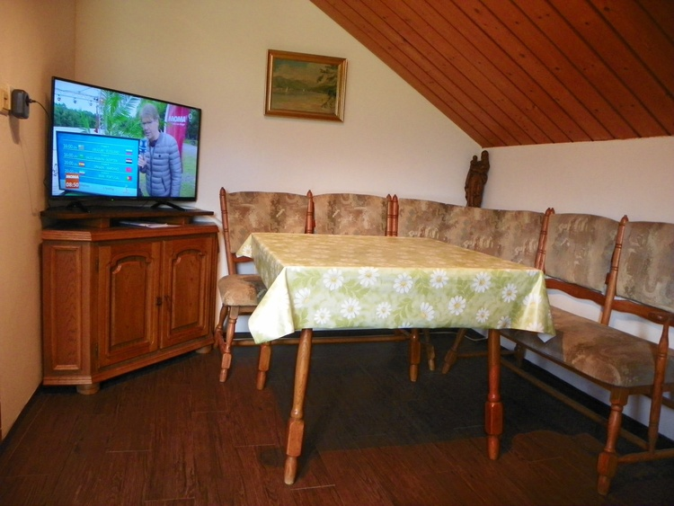 living and dining room with SAT TV on flat screen