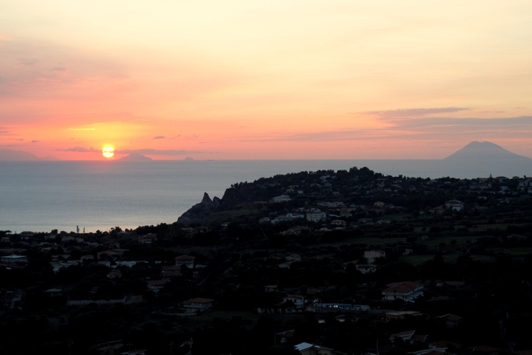 Sunset view from above Santa Maria showing Stromboli and the Aeolian Islands on the horizon